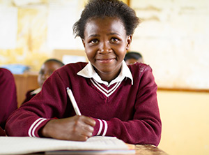 Photo of a smiling South African female primary student